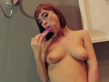 Cute redhead sweetie is naked because she like it