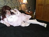 Sindy in white negligee on the bed