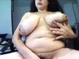 Chubby with huge tits plays on cam