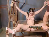 Brunette slave pussy clamped and toyed