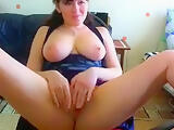 Webcam model Jane posing and playing with a dildo