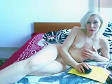 Mature blonde Viviena lies naked on the bed