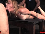 Hot blonde dominated by two cocks